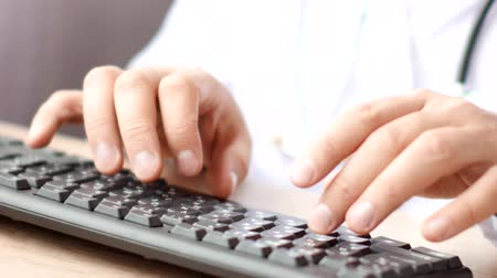 cabinet : Medical doctor hands typing rx prescription on computer keyboard