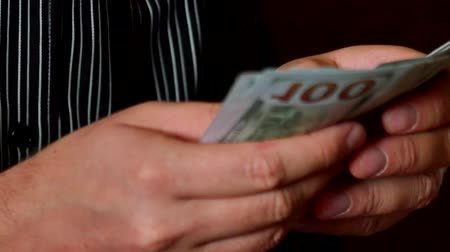 us banknotes : A businessmans hands counting hundred dollar bills Stock Footage