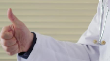 taça : Male doctor showing thumbs up Stock Footage