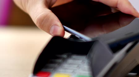 payment terminal : Person using contactless payment with smartphone.