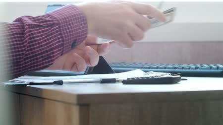refund : Man counting money and filling tax form