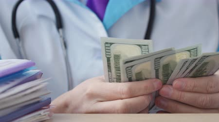corruptible : Corrupted medical doctor counting money.