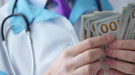 health insurance : Corrupted medical doctor counting money.