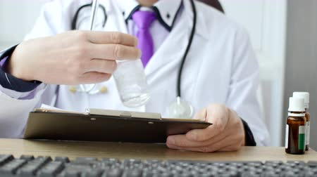 health test : Closeup of male doctor hand writing a medical prescription.
