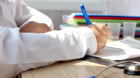 Young doctor is writting a prescription.