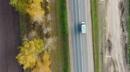 Aerial view of cars driving on country autumn road Dostupné videozáznamy