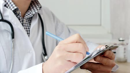 physician : Medical professional doctor writing RX prescription on clipboard