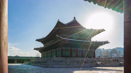 gyeongbokgung : Sun Flare with Gyeongbokgung Palace in Seoul, South Korea Time Lapse 4K Stock Footage
