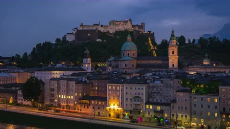 avusturya : Day to Night time lapse video of Salzburg old town with  Hohensalzburg Fortress in Austria timelapse 4K