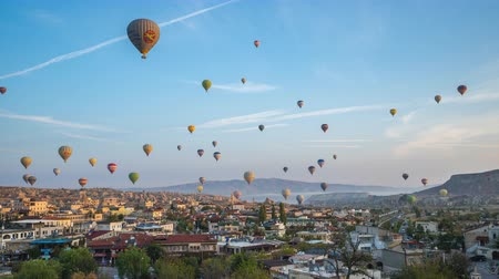 Cappadocia time lapse, Balloon are flying in Cappadocia with view of Goreme skyline in Turkey, timelapse 4K Стоковые видеозаписи