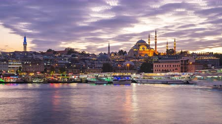 Istanbul, Turkey day to night time lapse of port near Galata Bridge in Istanbul, Turkey
