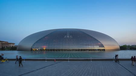 Day to night time lapse of National Centre for the Performing Arts in Beijing, China Стоковые видеозаписи