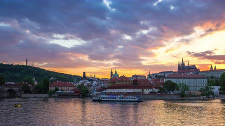Prague city skyline with view of Vltava River in Prague, Czech Republic day to night time lapse Стоковые видеозаписи