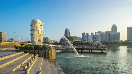 Singapore city, Singapore - April 9, 2018: Merlion landmark of Singapore city with cityscape skyline time lapse