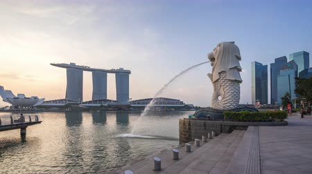 Singapore city, Singapore - April 9, 2018: Singapore Merlion Park night to day timelapse in Singapore city