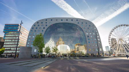 Rotterdam, Netherlands - May 13, 2019: Time Lapse of Rotterdam city with Markthal market in Rotterdam, Netherlands. Стоковые видеозаписи