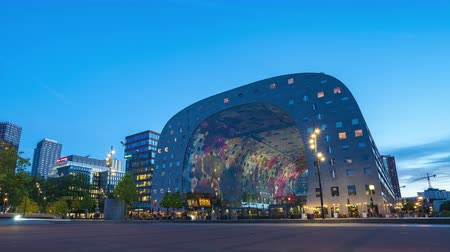 Rotterdam, Netherlands - May 13, 2019: Day to night time lapse of Rotterdam city with Markthal in Rotterdam, Netherlands.