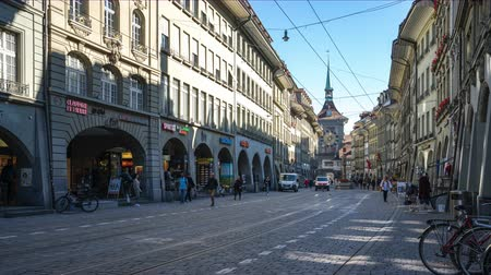 Bern old town with crowd of tourist and tram in Bern capital city of Switzerland. Стоковые видеозаписи