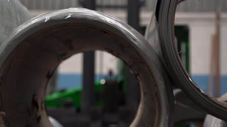 ironworks : Rolls of steel in metal work factory Stock Footage