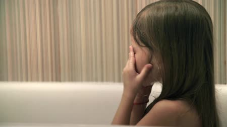 купаться : Little girl bathes play in a bath