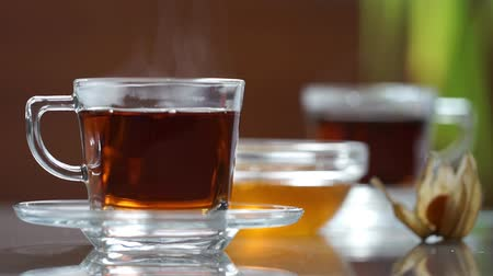 black tea : Transparent cup of tea on the table