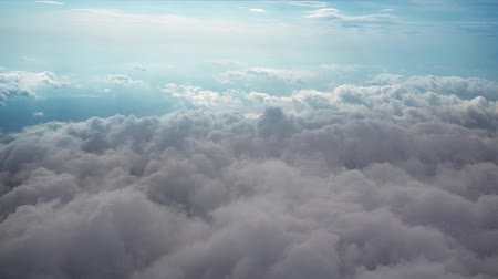 над : Airplane flying above clouds
