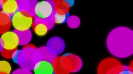 zaoblený : Circles background animation. Colorful circles slowly falling down on a dark background with particles flowing around