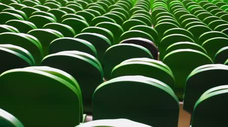 lugares sentados : Rows of seats in a football stadium.