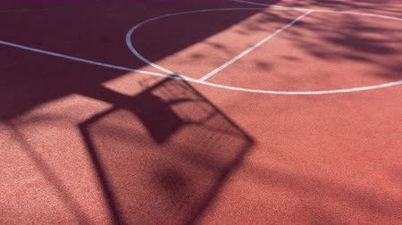 Shadow on the court of basketball basket with chains on streetball court Wideo