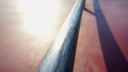 Iron rail at the skate park. Action movie.