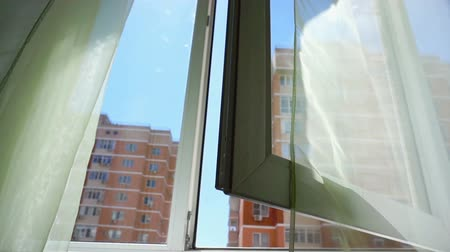 mysticism : Window with curtains and a view of the sky and city. Conceptual story of the room and open Windows.