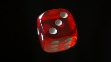 Red dice rotation on black background