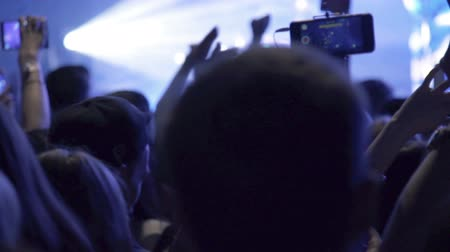 music band stage : Crowd making party at rock concert and hands hold many cameras with digital displays among people