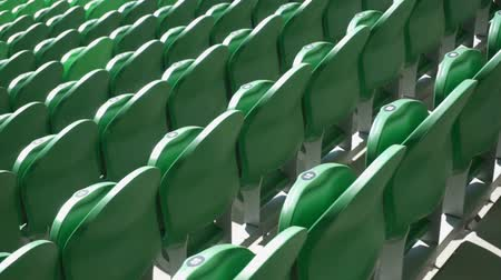 bleachers : Rows of seats in a football stadium.