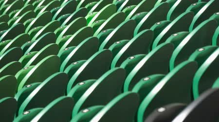 раздел : Rows of seats in a football stadium.