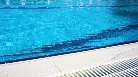 Blue surface water in the pool. Edge the pool.