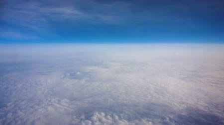 stratosfer : Above clouds, view from pilot cabine airplane. Blue sky, white clouds with magic and soft sun light. Stok Video