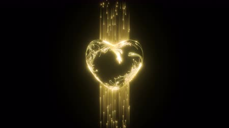 Glowing particles form the shape of the heart Stock mozgókép