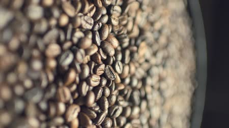Coffee beans on rotating plate Stock mozgókép