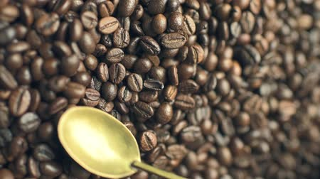Coffee beans mixing by a spoon Stock mozgókép