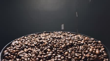 Coffee beans falling, Slow motion.
