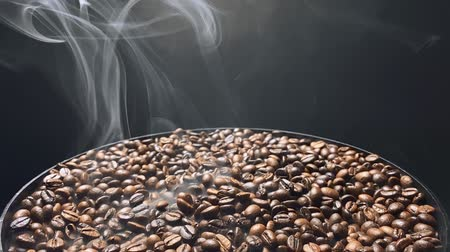 tahıllar : Smoke swirls over hot coffee beans. Slow motion. Stok Video