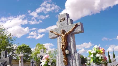 jezus : Stone cross with Jesus figure in a cemetery