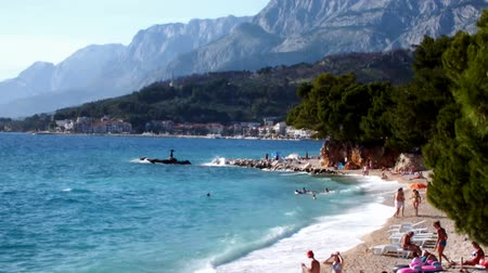 ointments : Mediterranean beach ; swimmers enjoy the sea and the waves of the great Mediterranean beach,video clip
