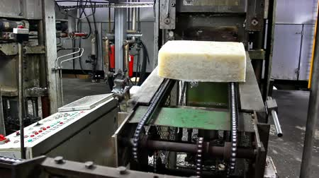 petrokimya : block of synthetic rubber ; block raw synthetic rubber out of the presses and going to the packaging line,video clip