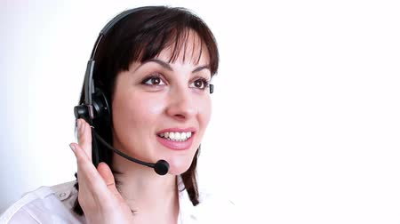 telecoms : Telephone customer service ; Beautiful young woman working in a telephone customer service,video clip