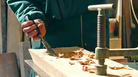 velo : Woodworking ; carpenter processing timber in his carpentry workshop,video clip