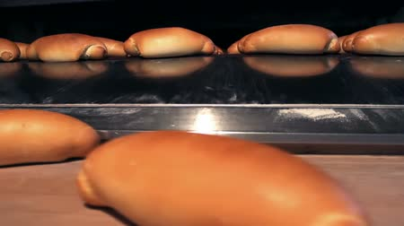roll : Oven for baking bread ; warm baked bread at the exit of the oven,video clip Stock Footage