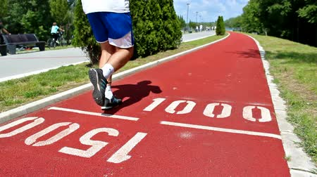 kilometer : Running Track ; recreation and sports running at the track of red tartan,video clip ;