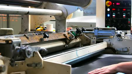 part of clip : Machine in the leather industry ; Worker in the leather industry operate machine for leather processing,video clip